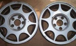 "$100 Nissan Maxima factory alloy rims, 15"", pair ...9 slot"