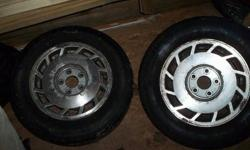 "$125 Maxima factory alloy rims....15"".....'tires were taken"