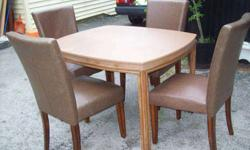 $125 one brown table and four brown leather and wood chairs