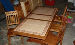 $150 Large dining table and 6 chairs