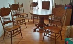 $195 OBO Oak dining room set: table w/6 chairs and leaf