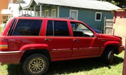 $1,200 1995 red jeep cherokee limited