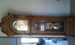 $1,200 7 ft Howard Miller grandfather clock