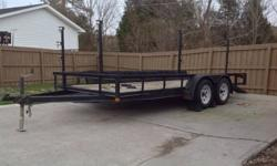 $1,250 16' Double Axle Flatbed Trailer with Front/Side Racks