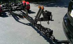 $1,500 EZ-Loader Roller Boat Trailer Auto adjusts to fit