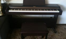 $1,500 OBO Roland Electric Piano and bench