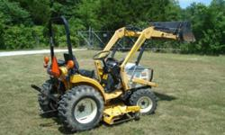 2000 cub cadet Model 7205 - Diesel 4x4 with all Attachments