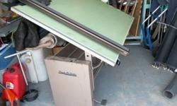 $200 Drafting table and drafting arm