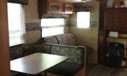 $21,000 2010 trailer, golf cart , awning and screen room at