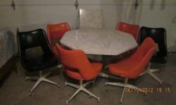 $250 Retro table with 6 swivel chairs