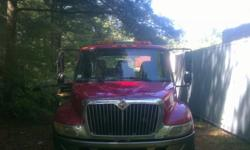 $25,000 Weekly 2002 International 4300 Rollback Tow Truck