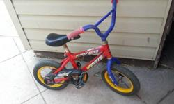 $25 12 inch Red Huffy Bike