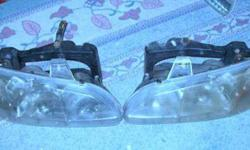 $25 2 Headlights 96 97 98 Pontiac Grand Am OEM LH RH