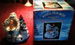 $25 Snow Globe Musical Rudolph The Red Nose Reindeer