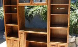 $289 Light Oak Entertaiment Center, holds books, blue rays,
