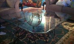 $300 Beveled glass top and copper base table
