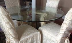 $300 Solid stone based table with thick glass top