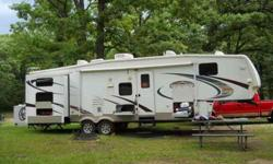 $33,000 Immaculate 2009 Montana Mountaineer DBQ Fifth Wheel
