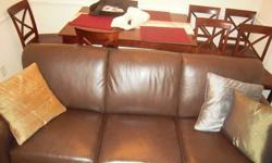 $400 Chocolate brown leather couch