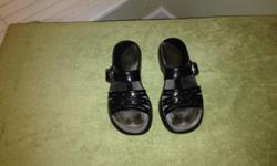 $45 Black Dansko slides