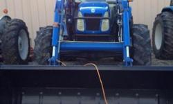 $48,000 2005 New Holland TLA90 Tractor