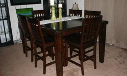 $499 Massive wooden dining table with 6 chairs