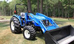 $4,800 2006 New Holland TC55DA 18LA Loader, Bucket, Bush Hog