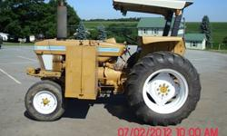 "$500 1985 ford 5610 tractor with a 60"" tiger rotary mower"