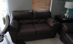 $500 brown leather couch and loveseat