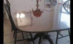 $500 Dining table with glass top/overlay