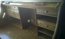$500 Large solid wood Roll Top Desk