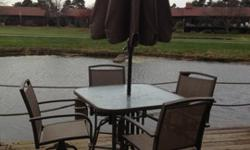 $500 OBO Patio high top table, 4 swivel chairs, umbrella in