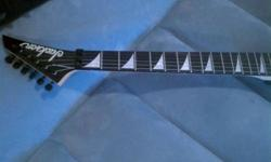 $580 Jackson Rhoads V *electric guitar*
