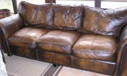 $600 BROWN LEATHER SOFA with hammered nail head trim, Great