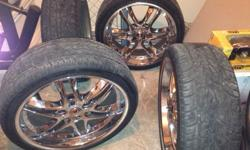 "$700 22"" chrome rims with tires"