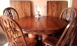 $800 9 piece solid oak dining room table, 6 chairs and 2-24""