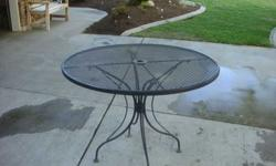 $85 Nice metal patio table seats 4 or 5. [phone removed]