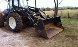 $88,000 2001 New Holland 7614 Loader