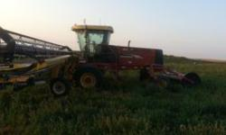 $90,000 2006 New Holland 325 Swather