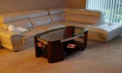 White Leather Sectional & Glass Coffee Table
